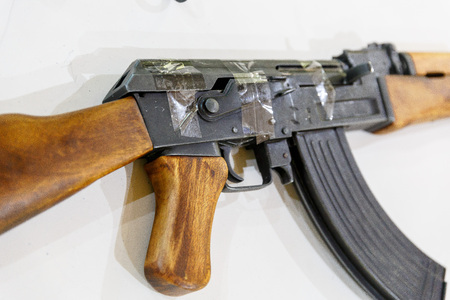 Kalashnikov rifle wrapped in scotch is on the table