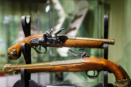 Ancient pistols and arquebus in a private collection Stock Photo