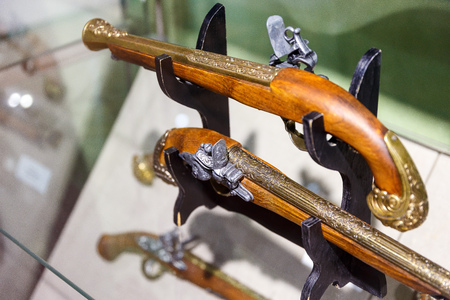 flintlock: Ancient pistols and arquebus in a private collection Stock Photo