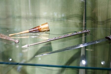 antiquities: daggers knives saber swords lie on the surface in a private collection Stock Photo
