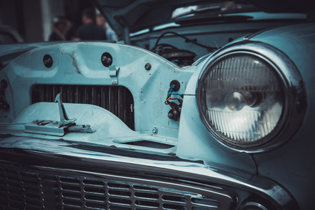 Headlights and body of an old classic car at an exhibition of vintage cars