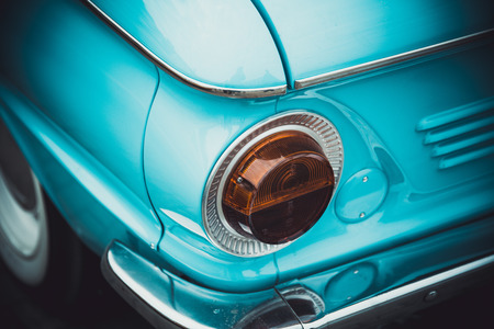 headlight: Headlights and body of an old classic car at an exhibition of vintage cars