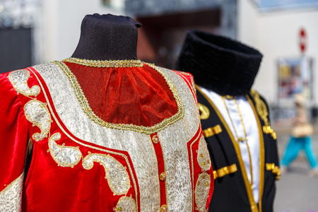 azeri: Azerbaijani national costume hanging on a street hanger Stock Photo