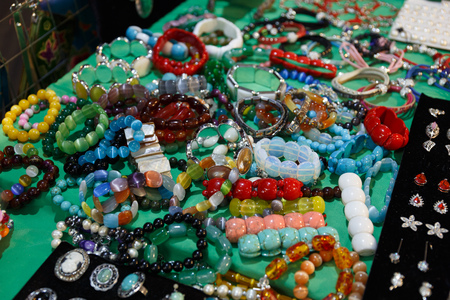 beautiful expensive jewelry, rings, amulets, necklaces, earrings in the store of elite jewelry