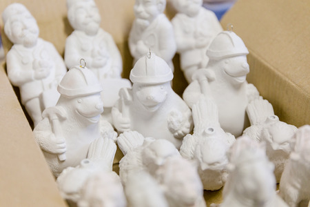 unpainted blanks of Christmas-tree toys in the warehouse of the factory for making Christmas-tree toys