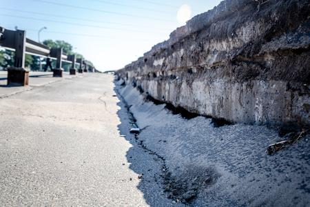 damaged asphalt at the broken bridge