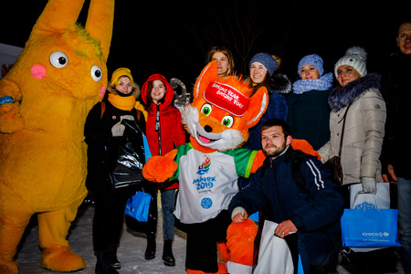 MINSK, BELARUS - 20 YANUARY, 2018: the mascot of the II European games fox Lesik is photographed with adults and children