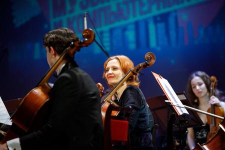 MINSK, BELARUS - 1 APRIL, 2019: Conductor directing symphony orchestra