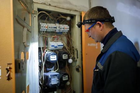 MINSK, BELARUS - 1 APRIL, 2019: electrician checks switchboard