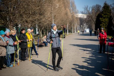 MINSK, BELARUS - 1 MARTH, 2019: older people doing Nordic walking exercises 新聞圖片