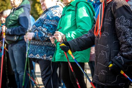 MINSK, BELARUS - 1 MARTH, 2019: older people doing Nordic walking exercises Editorial
