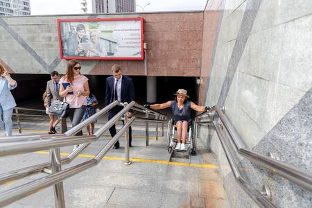 MINSK, BELARUS - 1 JUNE, 2019: a wheelchair user checks the barrier-free environment in the city