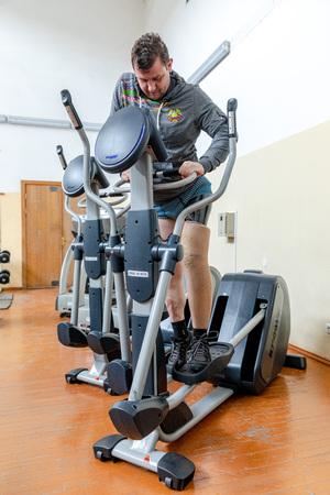 MINSK, BELARUS - 1 JUNE, 2019: disabled man in the gym, Disabled sportsman Concept 報道画像