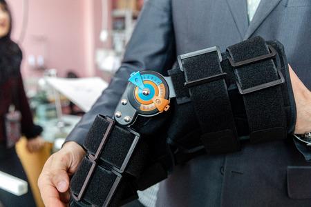 MINSK, BELARUS - 1 JUNE, 2019: surgeon holding prosthetic