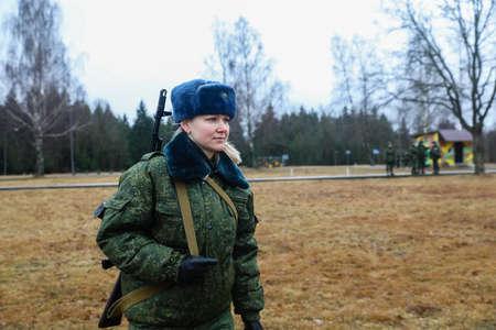 MINSK, BELARUS - 1 MARCH, 2020: woman soldier with gun Editorial