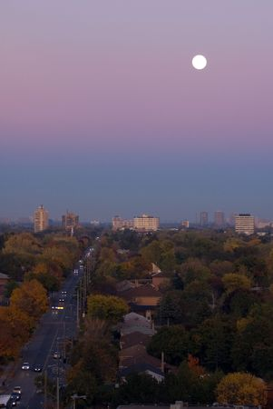 Moon above residential area of Toronto
