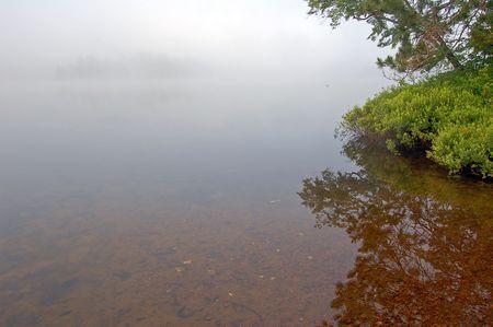 Strobg fog above lake in the morning