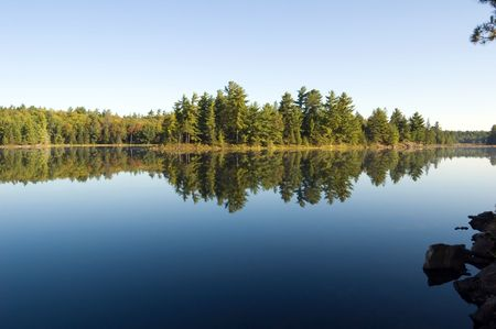 Lake in sunny pine forest in Killarney Park, Ontario