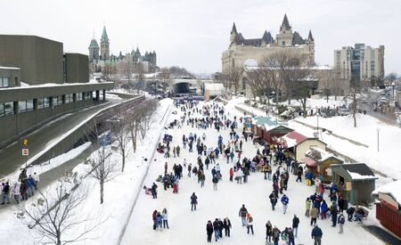 Skaters in ice of Rideau Canal, Ottawa.
