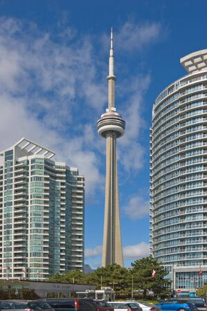 CN tower and high buildings on blue sky background