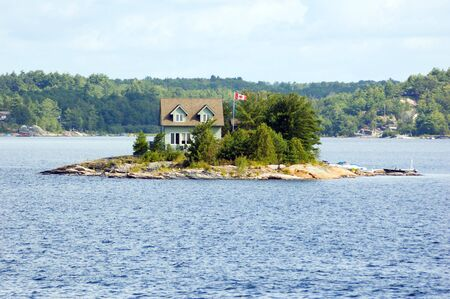 Lone cottage on stone small island