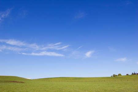 Agriculture farm fence under high blue sky Stock Photo