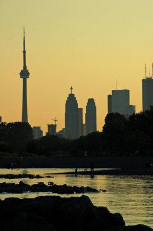 CN Tower. Toronto skyline from Ontario lake