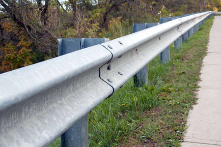 standard guardrail  Traffic barriers keep vehicles within their roadway standard guardrail  photo