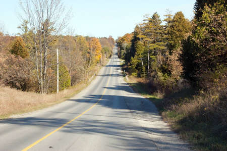 spaciousness: Country road through south Ontario under cloudy sky