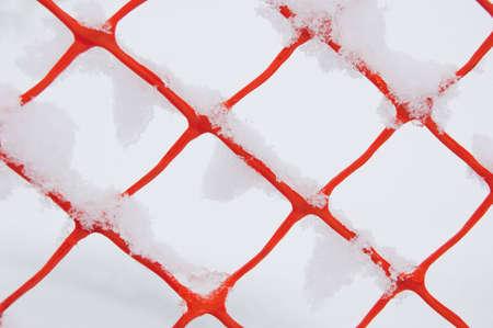 plastic fence on snow background photo