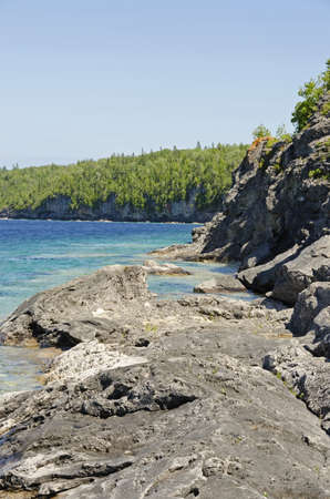 huron: Rock and clear water at shore of Georgian Bay Ontario Stock Photo