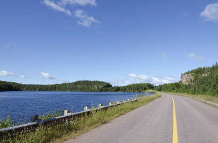 Highway along blue water lake shore Stock Photo - 13075484