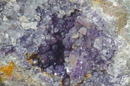 Amethyst druse over beige rock photo