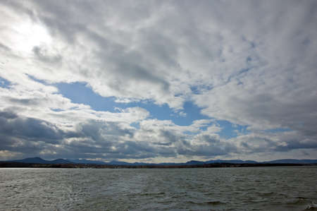 Lake Champlain water under dark clouds.