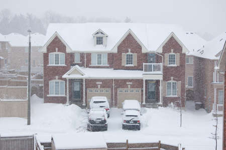 hause: Semidetached hause covered by snow in residential area Stock Photo