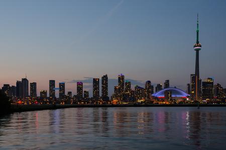 Skyline of Toronto over Ontario Lake after sunset