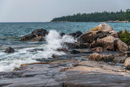 Surf at rocky promontory in Superior Lake Park. Canada