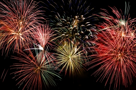 Colorful firework show finale with multiple bursts