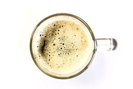 Mug of dark beer on the white background close-up
