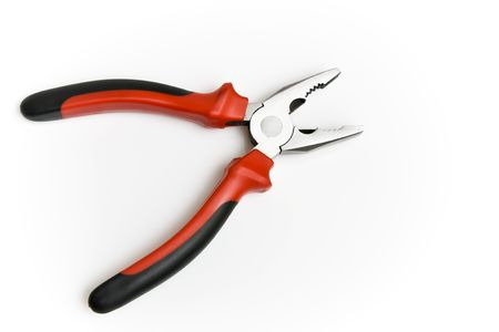 Black and red pliers isolated on the white background photo