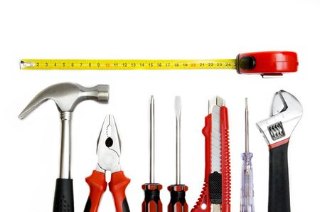 Set of work tools isolated on the white background close-up