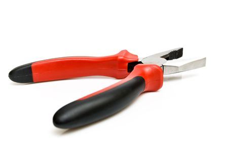 Black and red pliers isolated on the white background