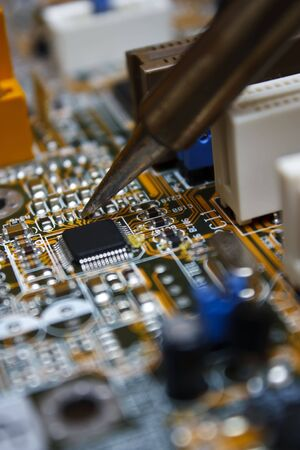 computer transistors: Repair electronic circuit board with soldering iron Stock Photo