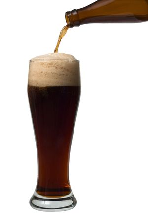 A beer pouring into a glass on the white background photo