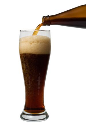 A beer pouring into a glass on the white background