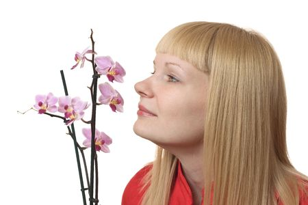 Portrait of a young woman with orchid on the white background Stock Photo - 6829848