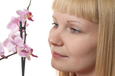 Portrait of a young woman with orchid on the white background Stock Photo - 6829849