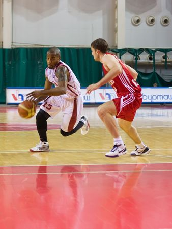 number 15: SAMARA, RUSSIA - APRIL 19: Luis Flores of BC Krasnye Krylia with the ball attacking player BC Lokomotiv-Kuban April 19, 2010 in Samara, Russia.