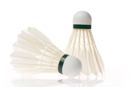 Two shuttlecocks isolated on the white background