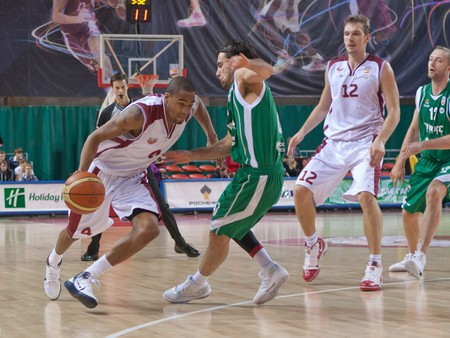 nesterov: SAMARA, RUSSIA - OCTOBER 24: Brion Rush of BC Krasnye Krylia with ball attacks a player of BC UNICS October 24, 2010 in Samara, Russia. Editorial